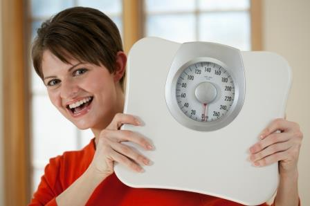 Attractive Woman Holding a Bathroom Scale